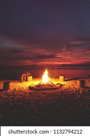 Bonfire on a beach in Gili Trawangan Island in Lombok, Indonesia with a modern style touch