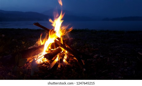 Bonfire on the lake in the mountains
