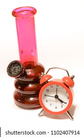 A bong and a clock to represent 4:20 themes.