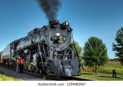 BONGARDS, MN  SEPTEMBER 8, 2018: Crew members do maintenance work on the steam engine Milwaukee Road #261 during a scheduled stop on its annual Autumn Tour from Minneapolis, MN to Glencoe, MN.