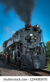 BONGARDS, MN – SEPTEMBER 8, 2018: Crew member makes final checks on the steam engine Milwaukee Road #261 during a scheduled stop on its annual Autumn Tour from Minneapolis, MN to Glencoe, MN.