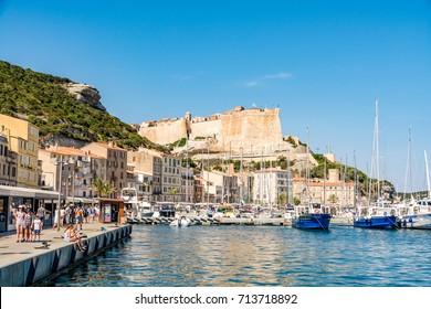 Bonifacio, Corsica, France - July 19, 2017: Marina with tourists in Bonifacio on a beautiful day