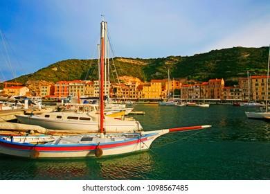 Bonifacio, Corsica island/ France - April, 16, 2018 : The harbor of Bonifacio at sunset with moored sailboats, Corsica Island, France