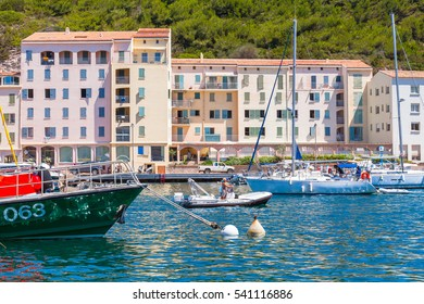 Bonifacio, France - July 2, 2015: Pleasure sailing yachts and motorboats with ordinary people goes on bay of Bonifacio, small resort port city of Corsica island in sunny summer day