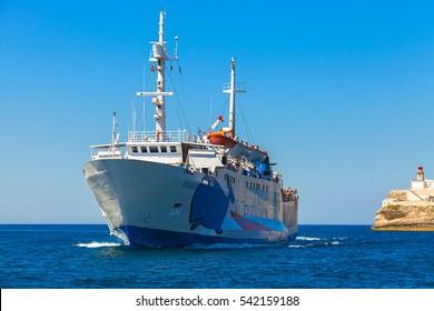Bonifacio, France - July 2, 2015: Travel from Sardinia on the Santa Teresa di Gallura Bonifacio. Ferry enters the port of Bonifacio, small port city of Corsica island in sunny summer day