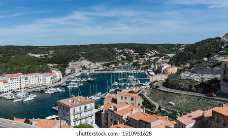 BONIFACIO, FRANCE - SEPTEMBER 14,2019: Aerial view of the harbor in Bonifacio, Corsica, an ancient city located directly on the Mediterranean Sea, separated from Sardinia by the Strait of Bonifacio.