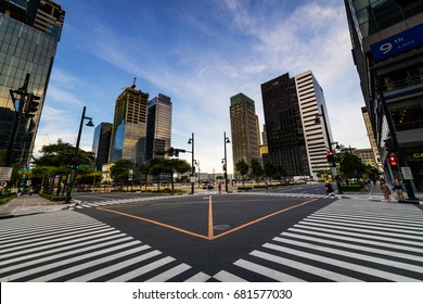 Bonifacio global city of Manila, Philippines. September 11, 2016: Empty cross section road view with skyscrapers in Bonifacio global city of Manila.