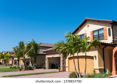 BONITA SPRINGS, FLORIDA - MARCH 27, 2019: New luxury real estate and condominiums for sale in Bonita Springs, Florida. Golf community development background