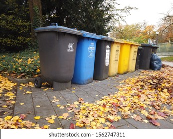 Bonn Germany, 12 November 2019: Trash Cans for separate collection of garbage in the autumnal street waits for service men