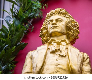 Bonn, Germany - February 17th 2020: A small statue of famous composer Ludwig Van Beethoven above a bar in the historic city of Bonn in Germany.  Beethoven was born in Bonn in the 18th Century.