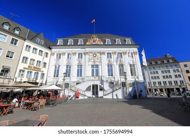 Bonn, Germany – June 11, 2020: Old town hall with unidentified people on a sunny evening in June. It was built in Rococo-style by the court architect M. Leveilly in 1737 - 1738.