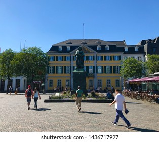 Bonn, Bonn / Germany - June 28 2019: Ludwig van Beethoven statue town square sculpture tourists clear blue sky cafe people