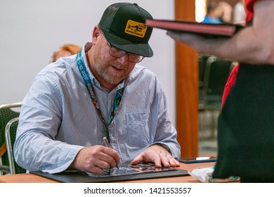 Bonn, Germany - June 8 2019: Robert Duncan McNeill (*1964, American actor and director - Star Trek: Voyager) signing autographs for fans at FedCon 28