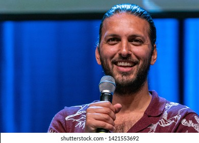 Bonn, Germany - June 8 2019: Shazad Latif (*1988, British actor - Star Trek: Discovery) talks about his experiences in Star Trek Discovery at FedCon 28