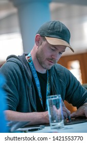Bonn, Germany - June 8 2019: Aaron Ashmore (*1979, Canadian actor - Killjoys  ) signing autographs for fans at FedCon 28, a four day sci-fi convention. FedCon 28 took place Jun 7-10 2019.