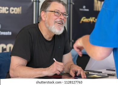 BONN, GERMANY - MAY 19th 2018: Jonathan Frakes (*1952, actor & director - Star Trek: The Next Generation) signing autographs for fans at Fedcon 27, a four day sci-fi fan convention