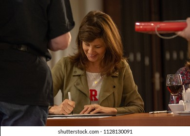 BONN, GERMANY - MAY 19th 2018: Daphne Zuniga (*1962, american actress - Spaceballs, Melrose Place. One Tree Hill) signing autographs for fans at Fedcon 27, a four day sci-fi fan convention