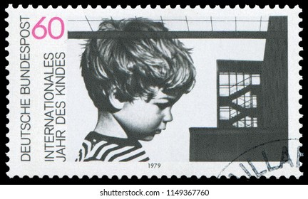 Bonn, West Germany - January 11, 1979: Child and building, stamp issued by German Post for the International Year of the Child and 20th anniversary of Declaration of Children's Rights.