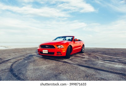 BONNEVILLE ,UTAH, USA JUNE 4, 2015: Photo of a Ford Mustang Convertible 2012 version at Bonneville Salt Flats,Utah, USA. The fifth generation began with the 2005 model year to 2014.TONED Image.