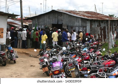 BONNY ISLAND, RIVERS STATE, NIGERIA, APRIL 15: A group of local workers meet on April 15, 2006 in Bonny Island, Nigeria. Situated in the Niger Delta, the island hosts various major oil companies.