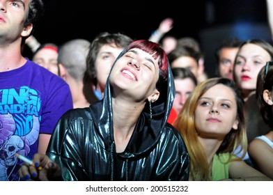 BONTIDA - JUNE 19: Crowd of partying people during a live concert at Electric Castle Festival on June 19, 2014 in the Banffy castle in Bontida, Romania.
