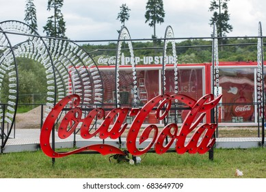 BONTIDA, ROMANIA - JULY 13, 2017: Empty Coca Cola bottles are arranged in a shape at Electric Castle festival