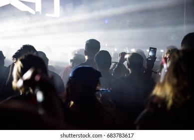 BONTIDA, ROMANIA - JULY 14, 2017: Crowd of people enjoying an electronic concert performed by Moderat band from Germany at Electric Castle festival