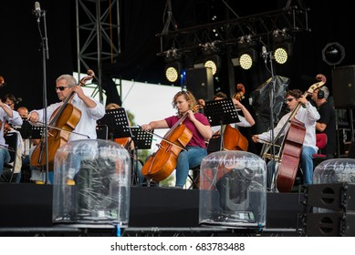 BONTIDA, ROMANIA - JULY 16, 2017: Hungarian Opera Philharmonia from Cluj performing live at Electric Castle Festival. Symphonic orchestra on the stage
