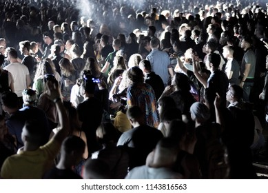 BONTIDA, ROMANIA - JULY 21,  2018: Crowd of partying people dancing during a Dj Excision live set at Electric Castle festival