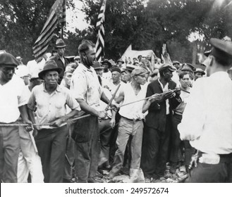 Bonus Marchers confront Washington, D.C. police, July 28, 1932. Veterans pushing the line forward in their battle, one with blood streaming down his face.