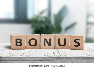 Bonus reward sign on a white table in a bright office with green plants