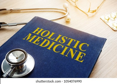 Book about holistic medicine and stethoscope.