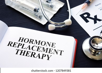 Book about Hormone Replacement Therapy and syringes.