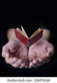 Book in the air with hands below