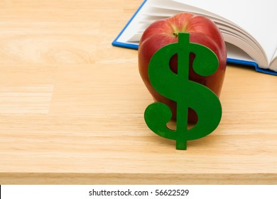 A book with an apple sitting on a table, Education Scholarships