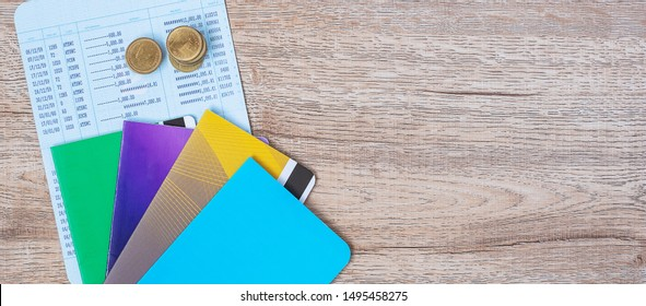 book bank and coins on wood table background with copy space. banking, business, investment, retirement planning, finance and Saving for the future concepts