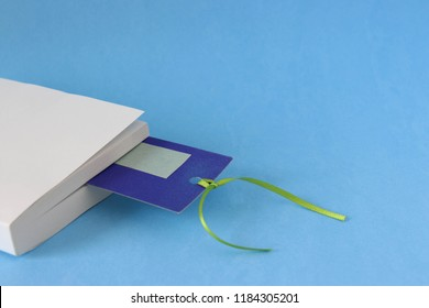 Book and bookmark on a blue background