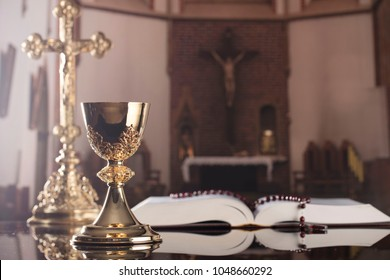 The book of Catholic Church liturgy and rosary and cross. Catholic theme.