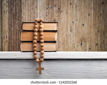 The book of Catholic liturgy and wood cross