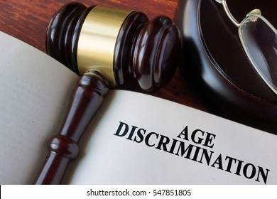 Book with chapter age discrimination and a gavel.
