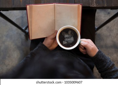 book and coffee in cafe