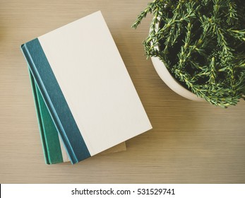 Book cover Mock up template on table with plant decoration
