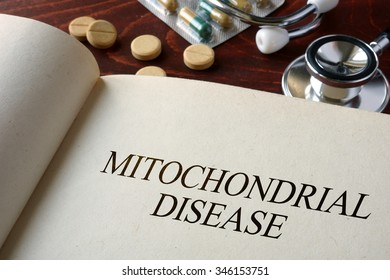 Book with diagnosis mitochondrial disease. Medical concept.
