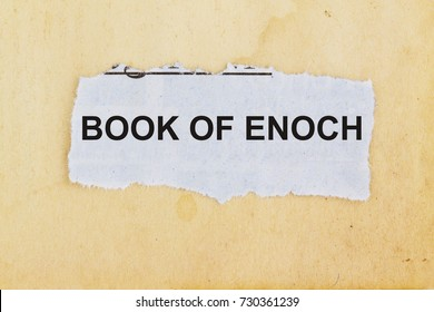 Book of enoch concept- newspaper cutout in an old paper background.