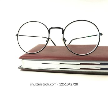 Book and eye glasses with old school concept