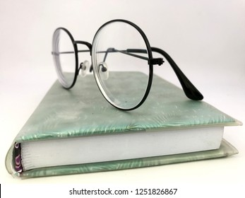 Book and eye glasses vintage with bokeh effect