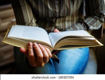 Book in female hands