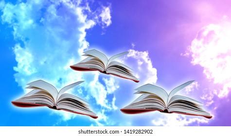 The book flew in the sky and white clouds floating in the background. The concept of education and reading Development of imagination