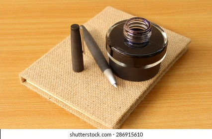 Book and fountain pen with ink bottle