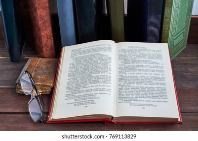 book and glasses on table
